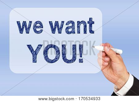 We want you - hand with marker writing blue text