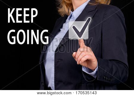 Keep going - Businesswoman with touchscreen checkbox and text