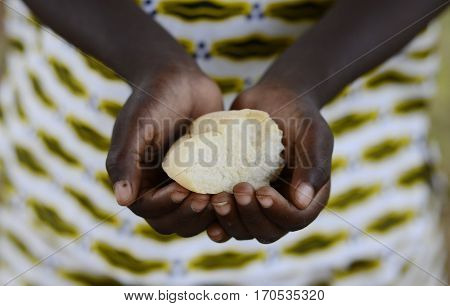 African child cupped hands holding some bread