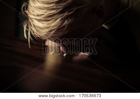 Teenage Boy Snorting Cocaine Off A Table