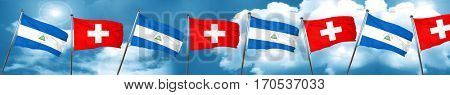 nicaragua flag with Switzerland flag, 3D rendering