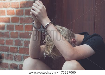 Dejected Teenage Boy Held Captive In Handcuffs
