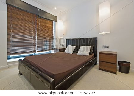 luxury bedroom with hanging lamp shades and vertical blinds