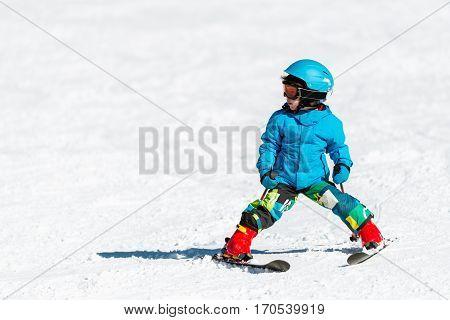 Little boy skiing convenient copy space, white