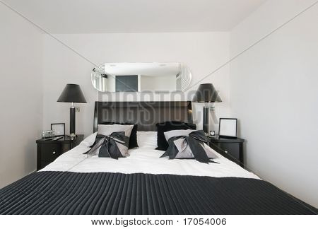 luxury bedroom with loads of accessory and designer furniture