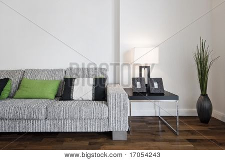 large contemporary designer sofa with side table and reading lamp
