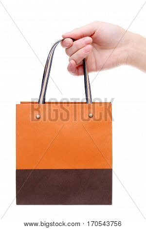 hand holding paper bag isolated on white background