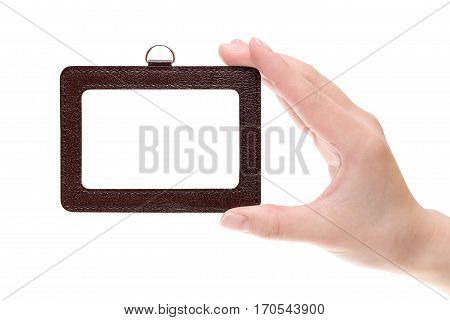 Hand holding blank identification badge on white background