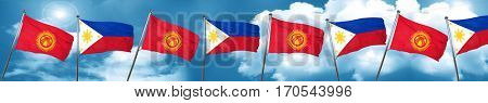 Kyrgyzstan flag with Philippines flag, 3D rendering