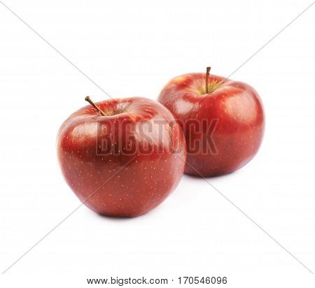 Two ripe red apples, composition isolated over the white background