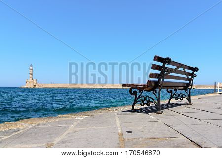 Bench with view on lighthouse of Chania town on Crete island, Greece