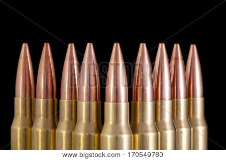 Isolated ammunition on black background.  Bullets are lined up for unique design.