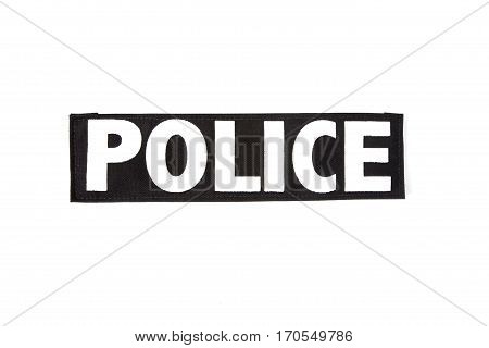 Isolated police patch on white field. Black on white.