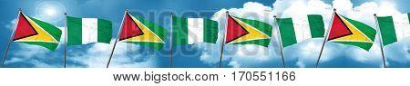 Guyana flag with Nigeria flag, 3D rendering