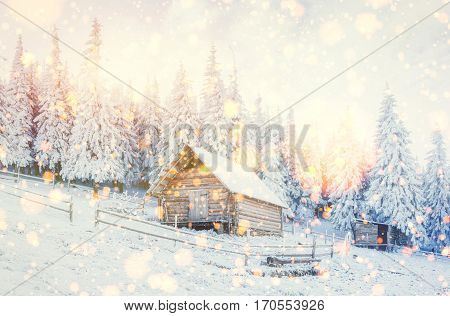 cabin in the mountains in winter,  background with some soft highlights and snow flakes