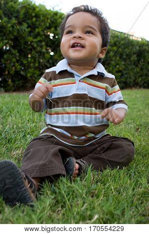Portrait of a Hispanic boy playing outside.
