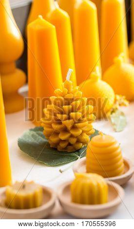 Beautiful yellow candles selling at a fair