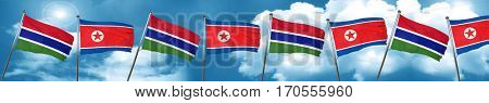 Gambia flag with North Korea flag, 3D rendering