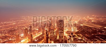 Beautiful night Dubai cityscape, panoramic view on amazing glowing at night luxury city, expensive life, center of business and travel, UAE