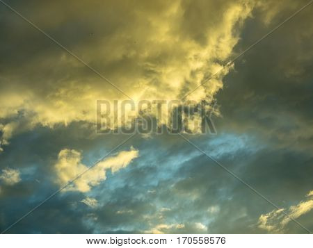 Dramatic sunset clouds with blue sky behind