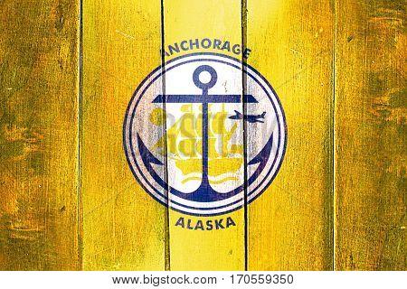 Vintage anchorage flag on grunge wooden panel