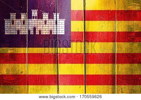Vintage Balearic islands, iles baleares flag on grunge wooden pa