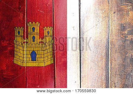 Vintage Castilla la manche flag on grunge wooden panel