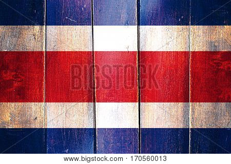 Vintage Costa Rica  flag on grunge wooden panel