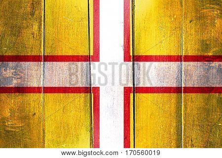 Vintage Dorset flag on grunge wooden panel