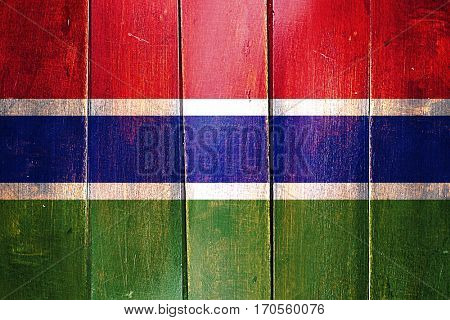 Vintage Gambia  flag on grunge wooden panel