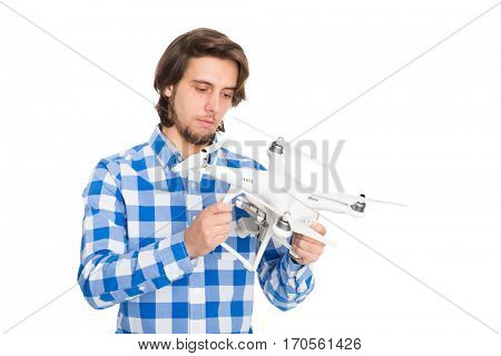 Man holds a flying drone with a camera. Isolated on white.