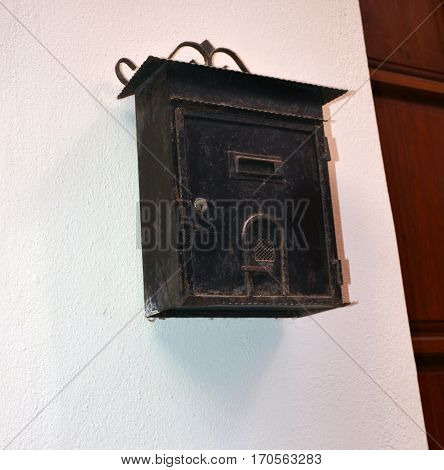 old and vintage mailbox on a wall of a house