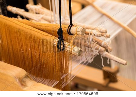 wood loom concept of fabric textile production or hobby
