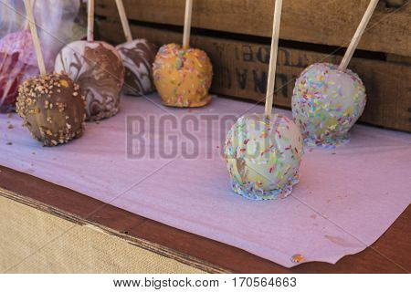 Apples covered with chocolates and assorted sweets at a traditional Spanish food fair