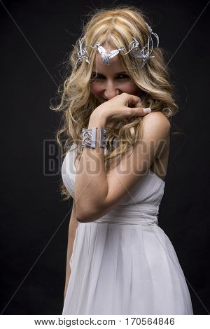 Greece, Beautiful greek blonde woman, mythology, dressed in white silk dress and laurel wreath handmade with silver