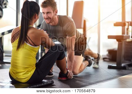 Man and woman looking at each other on training in gym