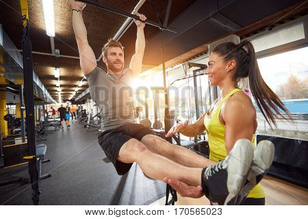 Body training in fitness center with instructor