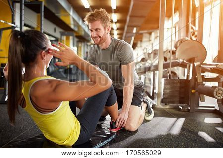 Fitness training with trainer in gym