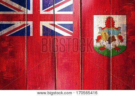 Vintage Bermuda flag on grunge wooden panel