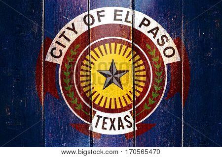 Vintage El paso flag on grunge wooden panel