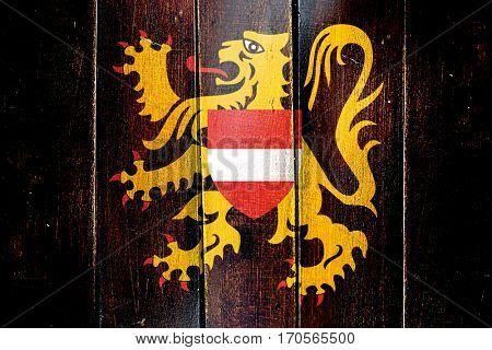 Vintage flemish brabant, vlaams brabant flag on grunge wooden pa
