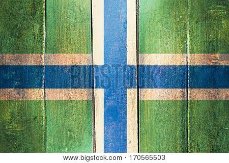 Vintage Gloucestershire flag on grunge wooden panel