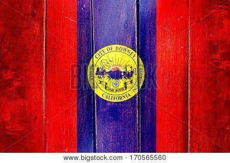 Vintage Downey flag on grunge wooden panel