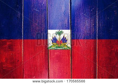 Vintage Haiti  flag on grunge wooden panel