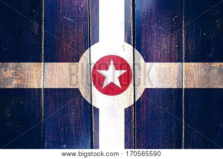 Vintage Indianapolis flag on grunge wooden panel
