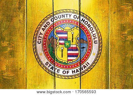 Vintage Honolulu flag on grunge wooden panel
