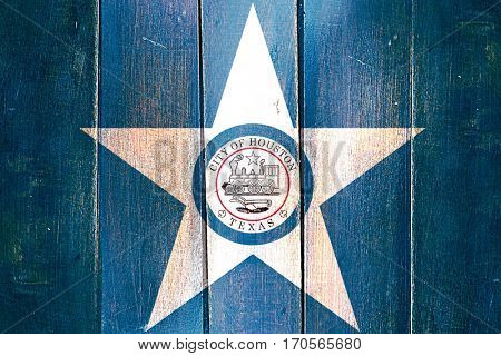 Vintage Houston flag on grunge wooden panel