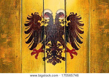 Vintage Holy roman empire flag on grunge wooden panel