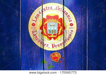 Vintage Lancaster flag on grunge wooden panel