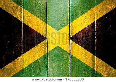 Vintage Jamaica  flag on grunge wooden panel